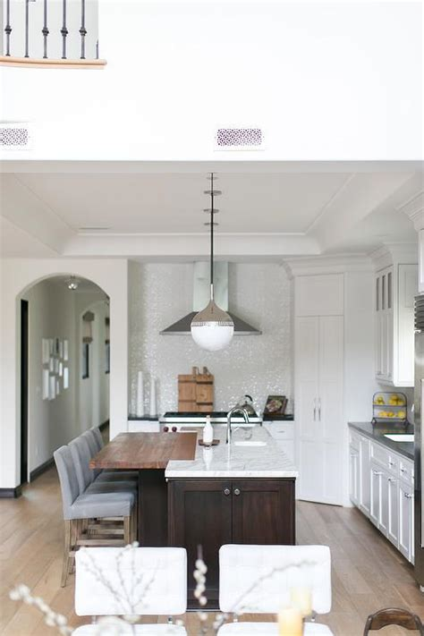 butcher block kitchen island breakfast bar white kitchen with gray quartz countertops and a white