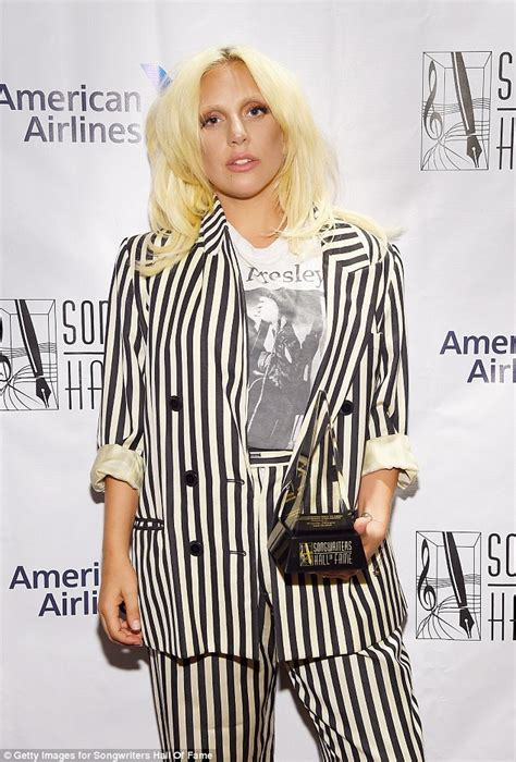lady gaga accepts contemporary icon award in bra and lady gaga receives top songwriters award at the hall of