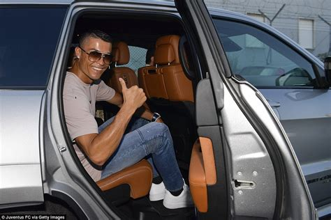 Fan Jumps Into Car by Juventus Fans Gathered For Unveiling Of Cristiano Ronaldo