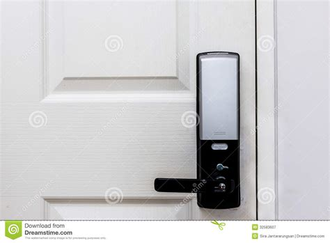 Electric Door Knob by Electric Door Locks On White Door Royalty Free Stock