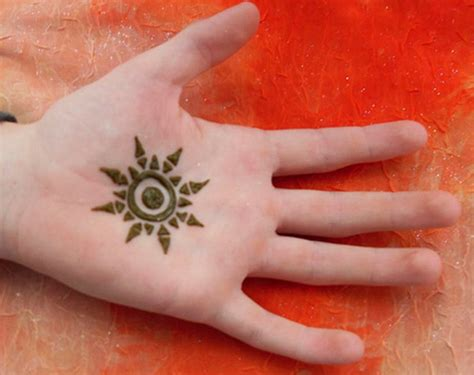 sun finger tattoo inside sun with henna sheplanet