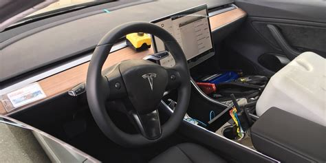 new interior image of tesla model 3 surfaces new tesla model 3 photos show us the clearest view yet of