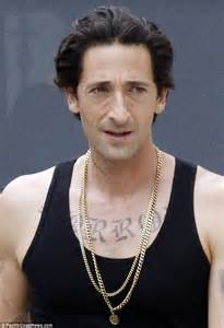 adrien brody is unrecognisable as he gets inked up on the