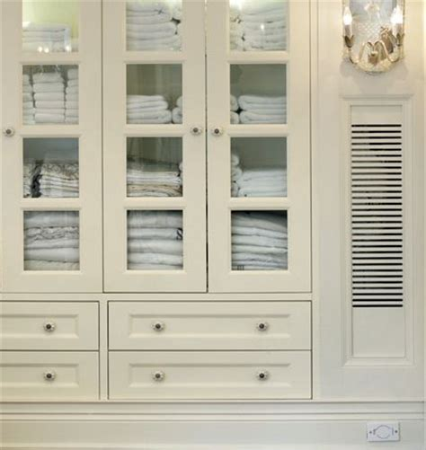 bathroom linen cabinet with glass doors built in linen closet white custom cabinetry with glass