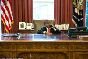 obama resolute desk adorable twitter photo shows obama making fun of young boy