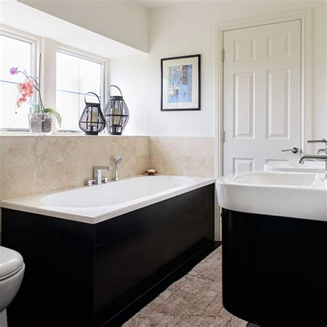 cream bathroom cream bathroom with black bath and basin housing