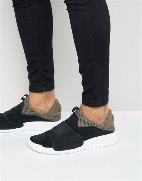 Nike Slip On Black Kode Ss6127 1 nike nike benassi slip trainers in black 882410 001