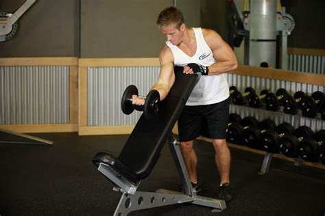 incline bench bicep curls standing one arm dumbbell curl over incline bench exercise