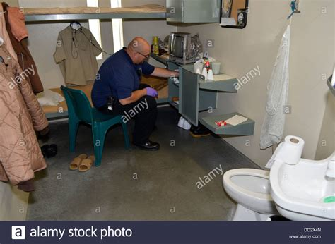 Find In Prison Unit Staff Conducting A Cell Search In A Maximum Security Prison In Stock Photo