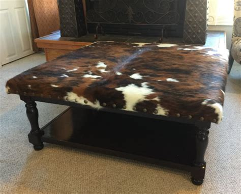 cowhide coffee table ottoman ottoman coffee table with cowhide upholstery and lower shelf