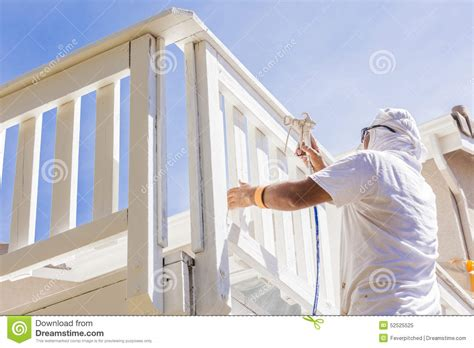 house spray painter professional house painter spray painting a deck of a home