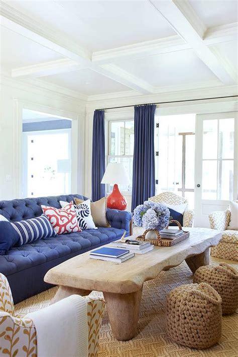 blue tufted roll arm sofa  rustic wood coffee table