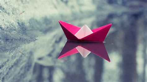 origami boat on water boat paper boats water ice reflection nature lake