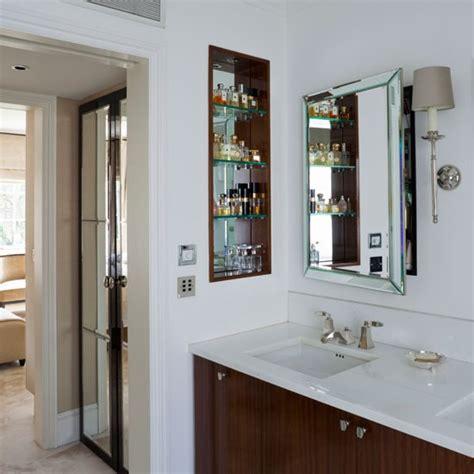 on suit bathroom en suite with smart cabinetry and open storage en suite