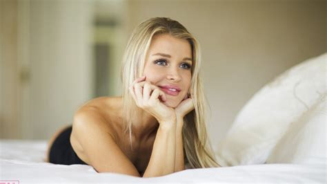 womens bedding joanna krupa gray eyes blonde lying on front black dress in bed smiling looking