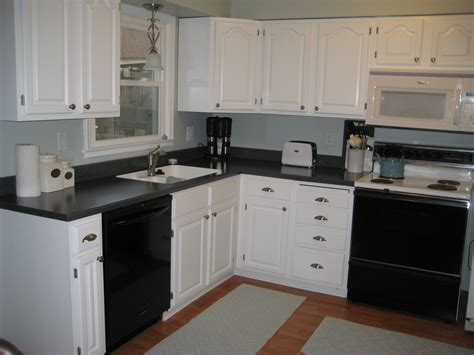 Black Kitchen Cabinets Pinterest White Cabinets Black Counters Kitchens Dining Rooms Pinterest