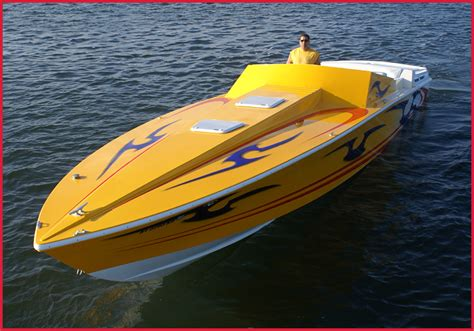 fast yellow boat speedboat cassatto airbrushing custom paints and design