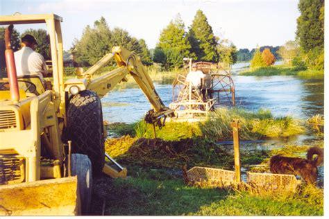 airboat pushes truck lake rake inc