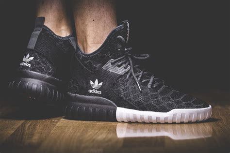 Adidas Tubular Primeknit Black on foot with the adidas tubular x primeknit quot black quot theshoegame sneakers information