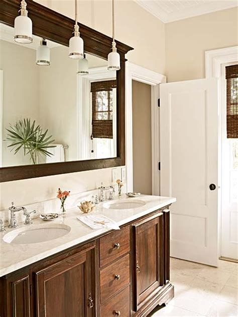 hanging mirror with lights instead of typical vanity lights above the mirror using