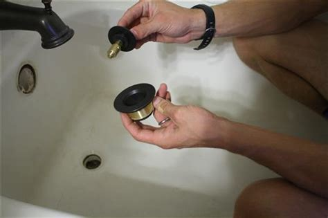 how to replace a bathroom sink plug hole how to replace bathtub drain trim kit