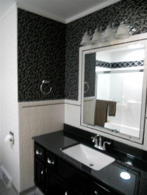 Our black & white guest bathroom before and after an update.