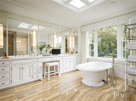 bathroom design seattle honey onyx tile flooring contrasts the white cabinetry by seattle cabinet design and white