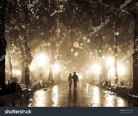 light for walking at night couple walking at alley in night lights photo in vintage