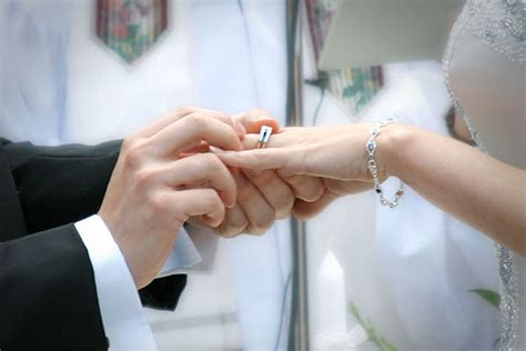 Wedding Ceremony Exchange Of Rings by Journalistic Wedding Photographer Photography Packages