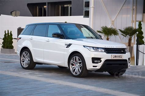 white land rover range rover vogue