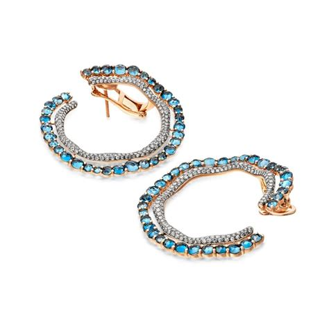 blue topaz fao hoop earrings astley clarke