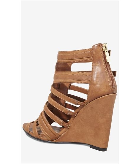 gladiator wedge sandals lyst express gladiator v wedge sandal in brown