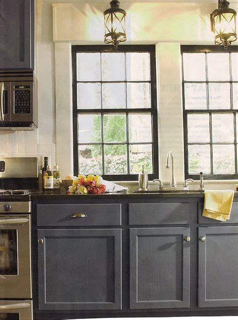 Lanterns and grey/blue cabinets. Black window frames