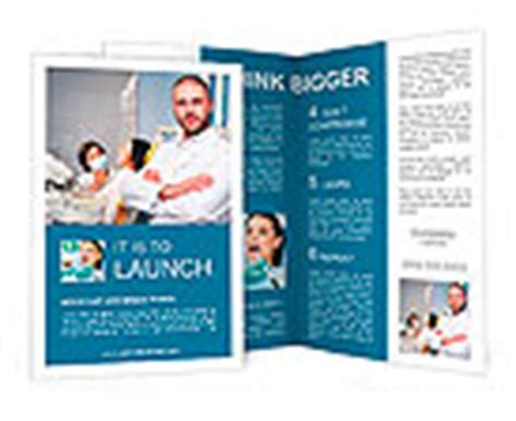 Friendly Male Dentist With Assistant And Patient At Dental Clinic Brochure Template Design Id Assistant Brochure Templates