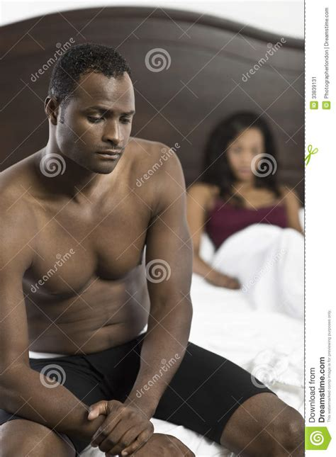 african men in bed tensed african american couple in bedroom stock image image 33839131