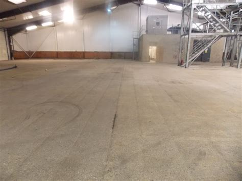 Black oily and dirty concrete floor slab restored by