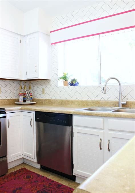 what is the best way to paint kitchen cabinets the best way to paint your cabinets classy clutter