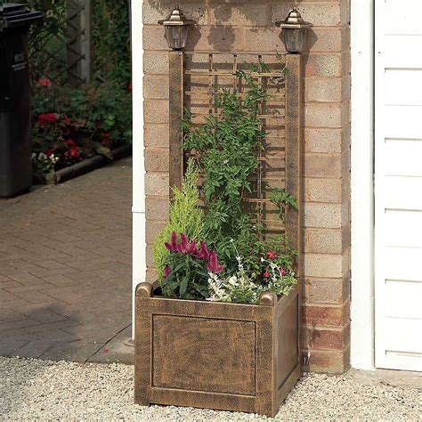 trellis planter with solar lanterns freemans