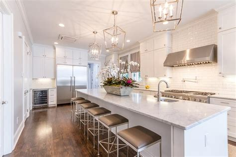 long island kitchen white beveled subway tiles with white shaker cabinets