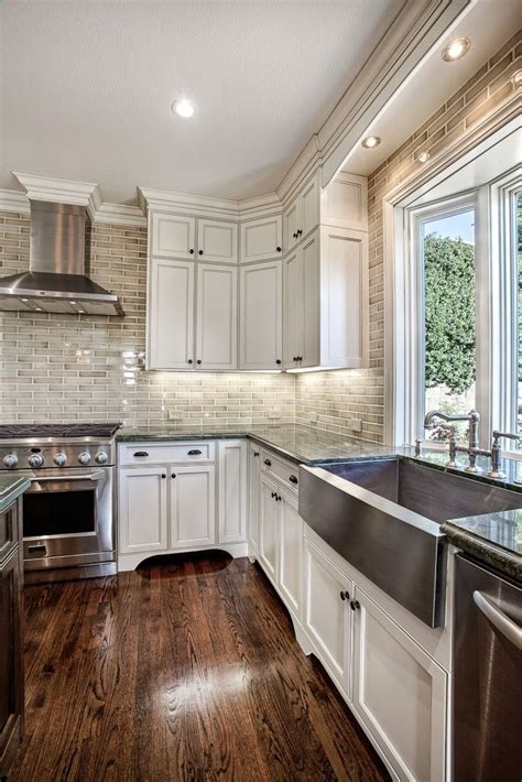 white cabinets hardwood floors and that backsplash house decorators collection