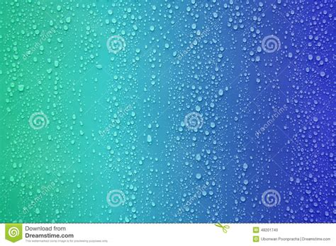 water blue color water drop on blue color gradient background stock photo