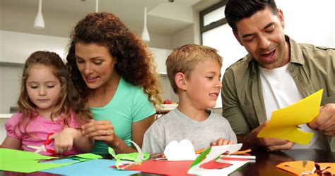 Cute Parents And Children Doing Arts And Crafts At Kitchen