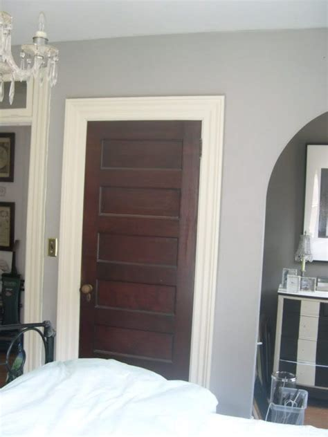 Love the white trim with dark stained doors i want to paint my trim white this may be a great