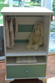 baby armoire with hanging rod baby clothes storage on pinterest baby closets