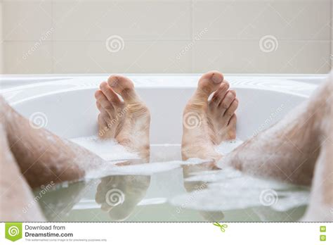 man in bathtub men s feet in a bathtub selective focus on toes stock