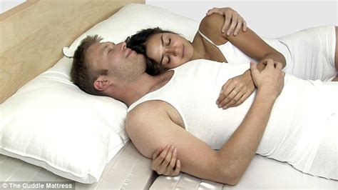 cuddling in bed the cuddle mattress lets you get close to your partner