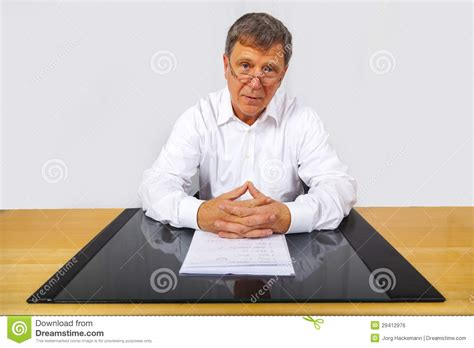 Man Sitting At A Desk Business Man Sitting At His Desk Royalty Free Stock Image