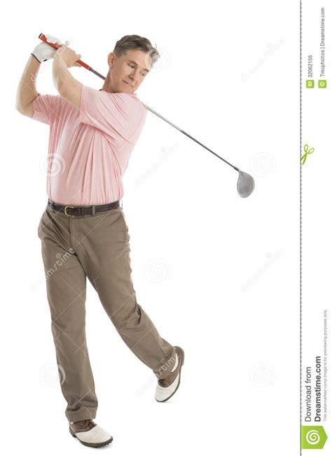 swinging man man swinging golf club against white background royalty
