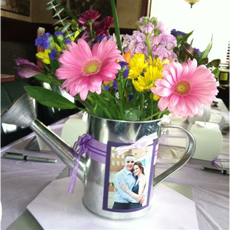 watering can centerpieces my best friend s centerpieces at bridal shower 04 29 12 made by me watering can