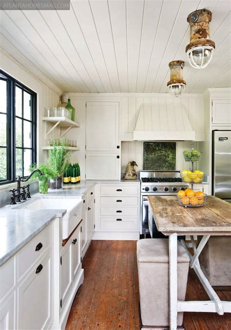 Cottage Kitchen Lighting Lovely Kitchen With White Wood Paneled Walls And Ceiling White Kitchen Cabinets With White